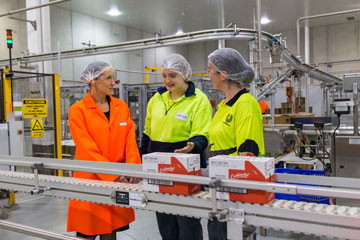 Geraldine Christou visiting a factory.
