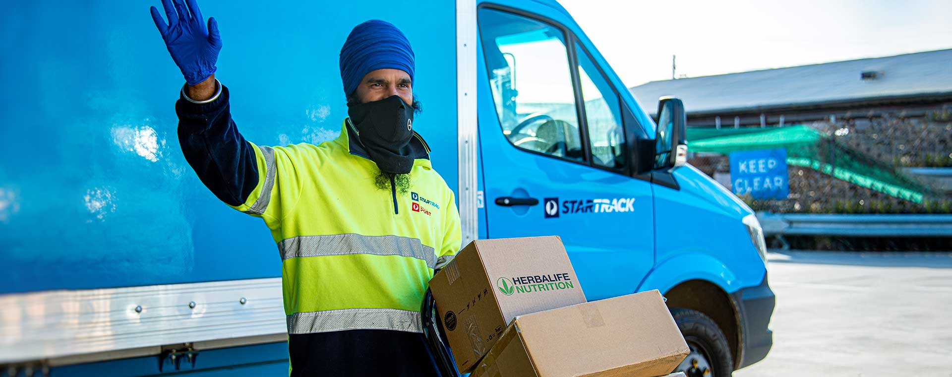 Delivery man wearing a mask