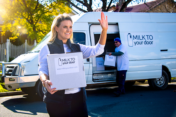 Woman making a home delivery of groceries